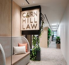 Studio SKLIM have completed the biophilic design for Cairnhill Law's offices located in Singapore. A verdant spine anchors the spatial organisation of an Corporate Interior Design, Corporate Interiors, Office Interiors, Law Office Design, Office Reception Design, Reception Ideas, Workspace Design, Office Workspace, Office Decor