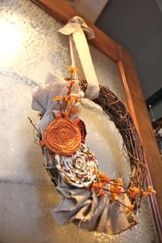 I've got a halloween plaque on my front door now, and a winter swag garland for christmas time.  I think I might actually be capable of making something like this for in between.  : )