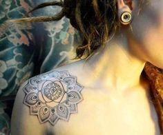 Simple black and grey dotwork shaded mandala tattoo on shoulder cap.