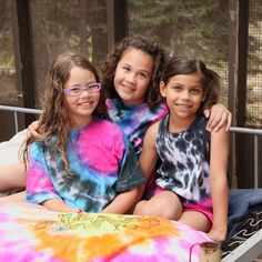 Cute for summer camp, a summer party or vacation, this tank top idea is a great craft to keep kids busy over their summer break! And, it's really easy with a Tulip® One-step Tie Dye Kit.