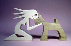 hauteur : 9 cm largeur : 17 cm épaisseur : 2 cm la femme est en érable, le chien en chêne