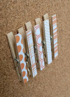 Clothespins with pushpins attached to the back. Great for bulletin boards.  Then cover with scrapbook paper and Modpodge!  etsy.com