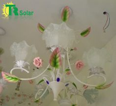Wrought iron ceramic flower chandeliers from TR SOLAR. email:sales05@solarledchina.com skype:eva900502 ICQ:681483337 http://www.aliexpress.com/store/product/Free-Shipping-Fashion-Modern-wrought-iron-Rose-Flower-pendant-lamp-5-Lighting-For-Bedroom-Living-room/210066_1286999504.html
