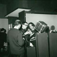 "Giovanni Anceschi showing Rotoplastik by Gianni Colombo at Miriorama 12 at Galleria del Cavallino, Venice, 1962. On the left, Gabriele Devecchi. Resting on the pedestal on the right Percorsi fluidi cubici (""Cubic Fluid Paths"") by Giovanni Anceschi"