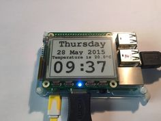 """E-paper 2.7"""" 264x176 pixel display for Raspberry Pi, sits neatly on top, with battery-backed Real Time Clock, accurate to < 3 min/year."""