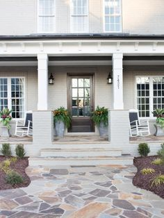 The curves of the attractive path that leads to the front door softens the front yard's manicured landscaping.