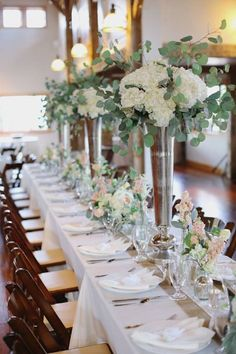 Tall sterling silver wedding centerpieces bring such a classic shimmer to the room. Photo: Forever Photography via Elizabeth Anne Designs