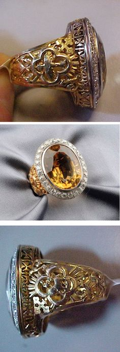 Citrine and Diamond Ecclesiastical Ring, bezel-set with an oval-cut citrine measuring approx. 19.40 x 14.40 x 10.55 mm, framed by old European-cut diamonds, approx. total diamond wt. 1.12 cts., the gallery pierced with Maltese Cross motifs, completed by an elaborate band with various Catholic symbols of a bishop, platinum-topped 18kt gold mount