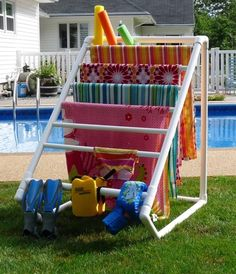 Towel rack for the summer using pvc piping!  GREAT idea! Could use to dry heavy items instead of using the dryer