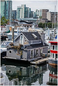 Floating Home in Coal Harbour, Vancouver, British Columbia, Canada. Floating homes have a long history on the West Coast. The first ones were log cabins on log floats built in the Locally, m… Vancouver Bc Canada, Vancouver Island, Vancouver House, O Canada, Canada Travel, Calgary, All About Canada, Western Canada, Floating House