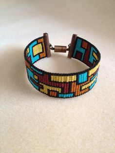Canyon Collage Cuff captures chasm colors. Cool! All kitted for looming.