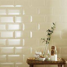 Add some bevelled edge tiles to your bathroom to give it a clean shiny finish in a classic neutral tone.
