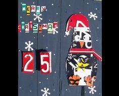 **How cute is this?!?** Funky Primitive Advent Calendar - Christmas Penguin - Recycled License Plate Art - Salvaged Wood - Upcycled Artwork. $129.00, via Etsy.