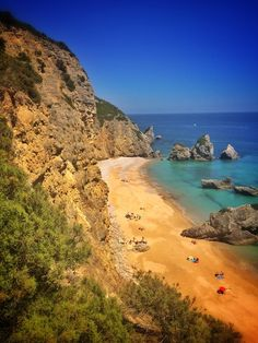 Ribeira do cavalo beach , Sesimbra- Portugal  OMG! This secluded beach is only reachable by boat or by trail. When u     get to the cliff to look below, all you can...