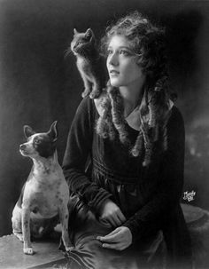 Mary Pickford with a cat and dog