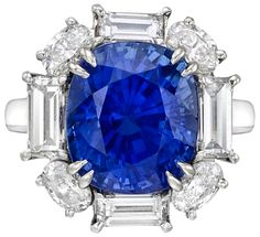 Sapphire and diamond ring set with a 7.11 carat cushion-cut sapphire and just under 3 carats of baguette and oval-cut diamonds. Via Diamonds in the Library.