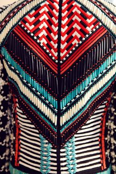 Beaded jacket in geometric graphic pattern, detail. Backstage at Balmain Spring / Summer 2015, Menswear. Photo: Marie-Amélie Tondu http://www.dazeddigital.com/fashion/gallery/18084/17/balmain-ss15