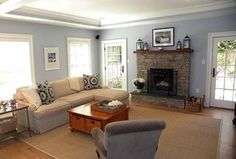 Traditional Living Room with stone fireplace, Carpet, Hardwood floors