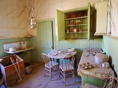 Bodie. Typical kitchen and eating area. (I guess the axes are for killing the chicken).