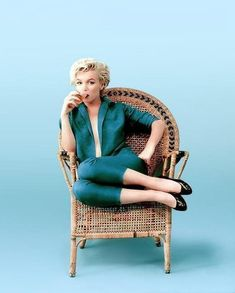 Marylin Monroe wearing the same open cut blouse she had worn for the Baron session, poses for Milton Greene in just one of the many wicker chair shots. Greene's use of color and his fashion photography background created an image ready for the likes of Vogue or any other fashion magazine, years before Bert Stern's Vogue assignment.