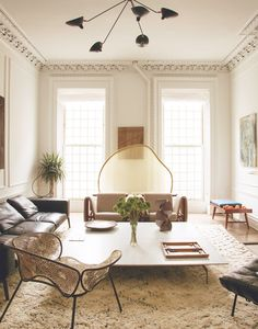 Décor Formulas That Always Look Expensive via @MyDomaine Tone-on-tone spaces always look chic. It's the equivalent of a monochrome camel outfit. To achieve the look, ground your space with a Moroccan Beni Ourain rug, add a neutral loveseat, and draw the eye up with a statement modern chandelier.