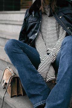 Nisi is wearing: Gucci Dionysus bag, Aviator jacket, Striped top, Flared denim jeans - teetharejade.com