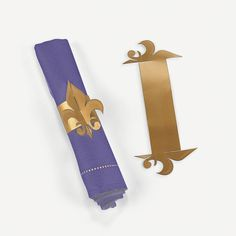 Fleur De Lis Napkin Rings - OrientalTrading.com- themed dinner? get colored fabric and have fabric napkins?