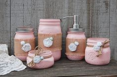 Shabby chic mason jar bathroom jar set. Hand painted in soft pink, lightly distressed, wrapped with burlap, tied with jute and white roses, finished with a protective coating. Metal soap dispenser, to