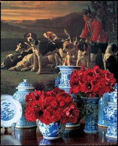 red flowers & blue italian ginger jars (this is actually similar to what i want at my wedding, but with white flowers)