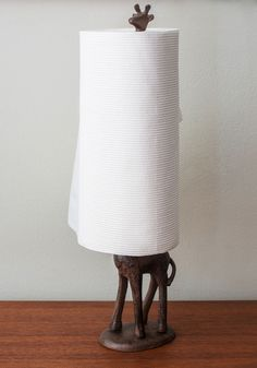 The Neck is Stacked Paper Towel Holder. Add a dash of safari-inspired charm to your dwelling with this unique paper towel or toilet paper holder.