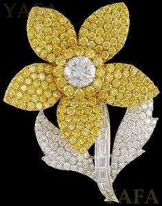 "18k white gold diamond and yellow diamond flower brooch, signed Graff. Approx. 2 1/2"" x 2"""