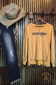 The Salinas - Distressed Wrangler sweatshirt. Super soft distressed mustard. Angled side zipper details. RustIc Wrangler graphic. Cut up hi-lo hem. Nice fit, somewhat slimmer, not boxy.