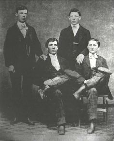 Frank James (seated, right), Cole Younger (seated, left), Jim Younger ...