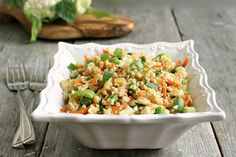 Cauliflower fried rice is healthy but filled with the greasy goodness of the original dish.