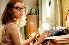 Love this image!  A young bespectacled lady at a typewriter- endless possibilities!!!