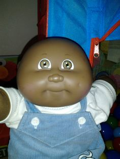 My Cabbage Patch doll looked like this, with a Mets Uniform. Named him Daryl Strawberry.  Still have him