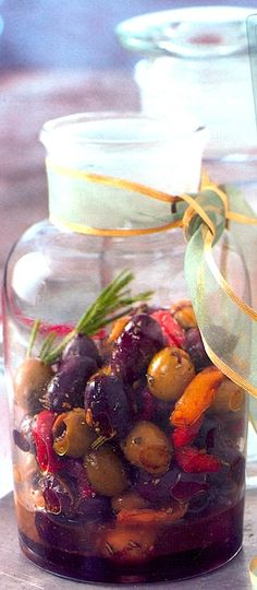 "Citrus-Marinated Olives with Roasted Peppers _ ""Greek Kalamata olives are large, rich & fruity & are a dark eggplant color. The flavors in this recipe are a perfect match for them."" Garnish with rosemary sprigs & orange spirals."