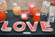 A candy bar that is as sweet as its inspiration, l-o-v-e.  See more bridal shower decorations and party ideas at www.one-stop-party-ideas.com