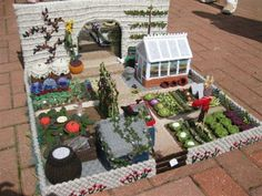 "Knitted garden to go on display in the UK. ""The Knitted Garden was made by Knitters Anonymous, a knitting group based around Bledlow Ridge and Radnage."""