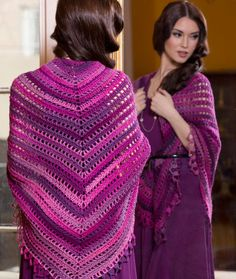 This gorgeous shawl combines a beautiful design with a wonderful, shaded yarn. Crochet it starting at the center top and work your way down to the lacy, scalloped edge.