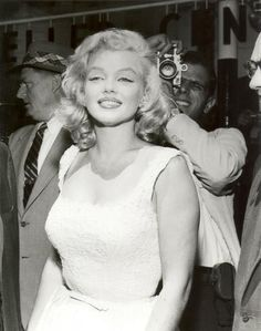 Marilyn at Rockefeller Center to help launch the construction of the new Time-Life Building, NYC, July 2, 1957.