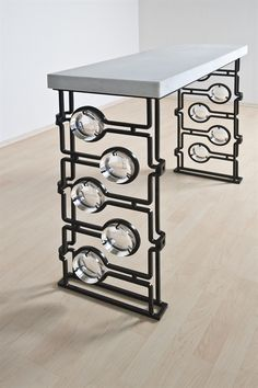 Christophe Côme : Console    The glass and ironwork pattern would make an awesome room divider.