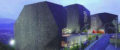 Biblioteca España en Medellín Giancarlo Mazzanti, Exterior, Opera House, Building, Travel, Rock Wall, Light Panel, Small Windows, Spain