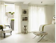 White bedroom with minimal green accents - Kelly Hoppen