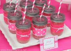 Mason jars became cups for pink lemonade after the hostess wrapped them in ribbon and topped them with lids from We Love Citrus. Straws were from Cakes and Kids Too, and the label was created by Chickabug. Get all the project details here.  Source: I Heart Nap Time