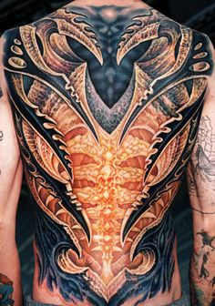 not my style but WOW! that's some amazing ink!!!