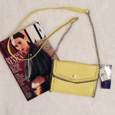 Adorable yellow bag! Cute little yellow cross body bag with silver chain. Perfect for spring! Bags Crossbody Bags