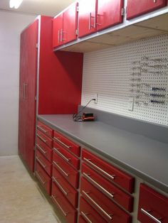 work bench layout...full end cabinet, base units with drawers, pegboard back, work table, and upper cabinets