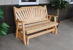 Amish Cedar Wood Fanback Glider Charming outdoor glider made with solid pine. Available unfinished if you so choose.