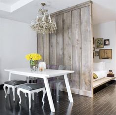 love the play of textures in this room - rough wood with clean white table and chandelier.
